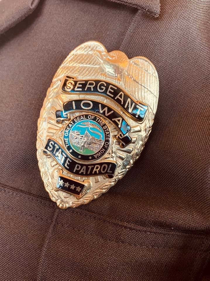 Photo of Iowa State Patrol's gold Sergeant badge.