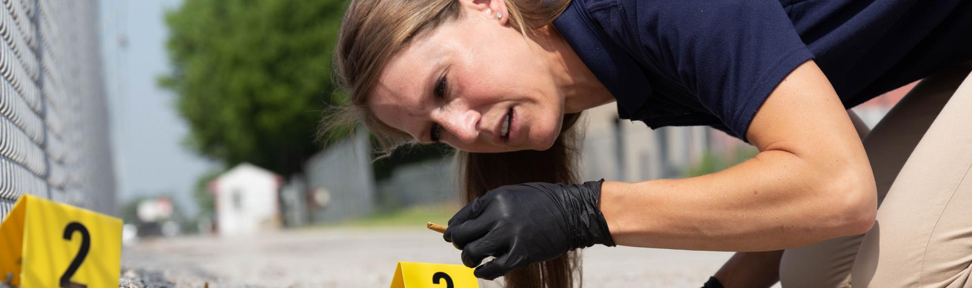 Agent identifying evidence at a crime scene.