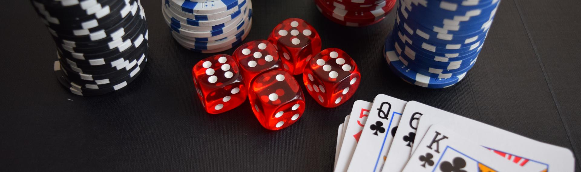 Image of gambling chips, dice and cards.